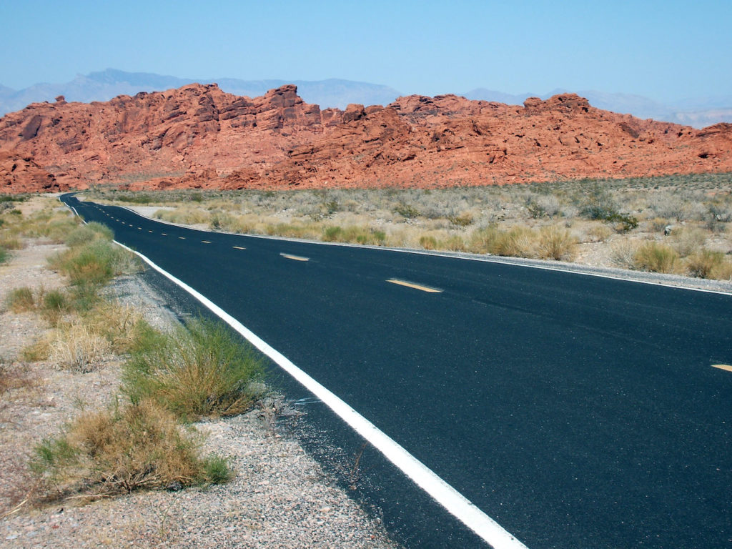 A straight well-paved 2 lane road leading into the Valley of Fire State Park, Nevada